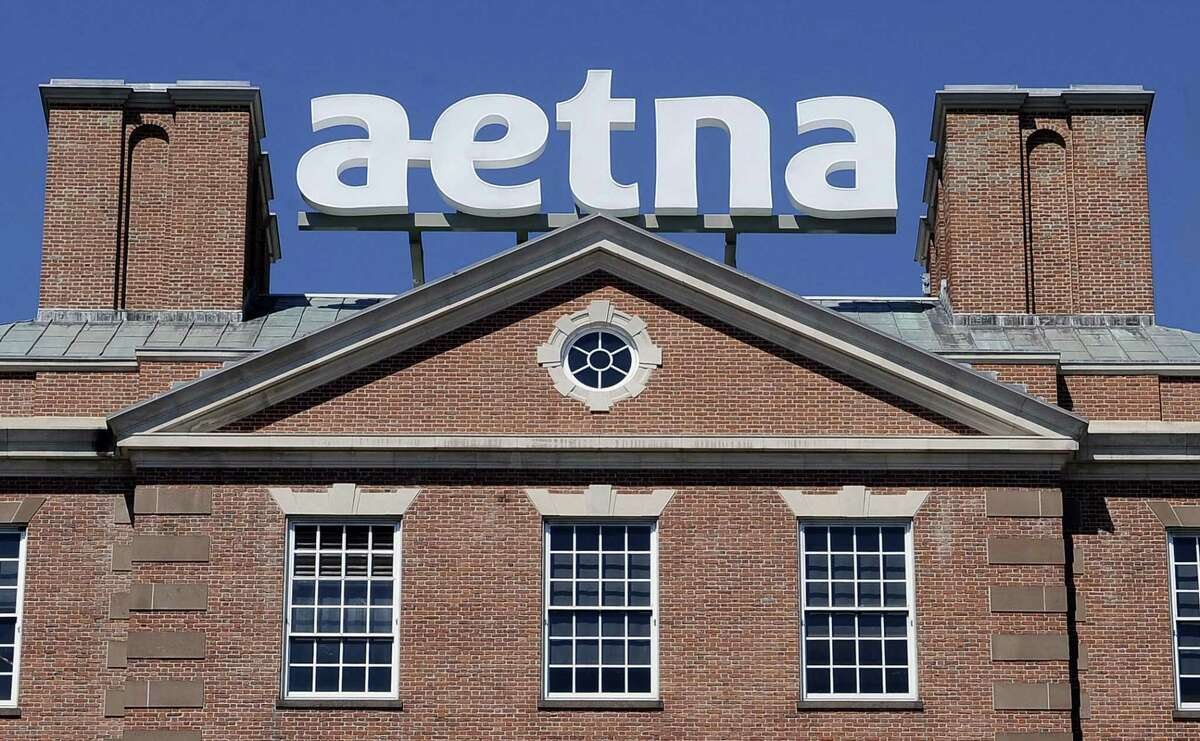 A sign for Aetna Inc. sits atop a building at the company headquarters in in Hartford.