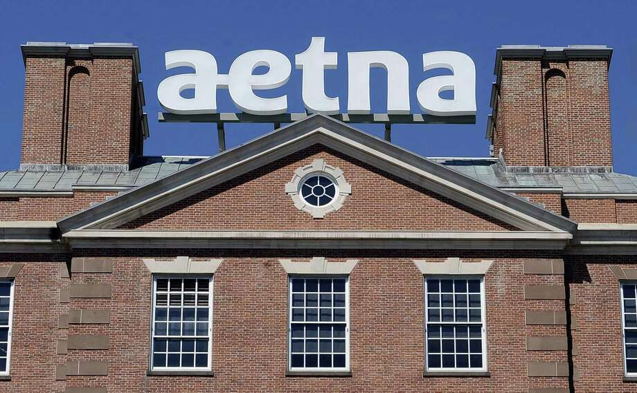 A sign for Aetna Inc. sits atop a building at the company headquarters in in Hartford. Photo: Jessica Hill / Associated Press / FR125654 AP