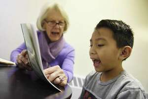 Volunteer Pat Young, the former Headmistress at Stanwich School, tutors Greenwich's Charles Cajas, 8, at Family Centers' Family First in Education program at the YMCA Early Learning Center in the Chickahominy section of Greenwich, Conn. Tuesday, Jan. 29, 2019. The program attempts to bridge the socio-economic opportunity gap by offering an after school tutoring service and home visits to ensure parents get involved with their children's educations.