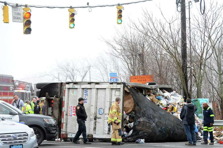 A garbage truck, like this one that rolled over in April 2018, crashed on High Ridge Road Thursday, March 14. Photo: Michael Cummo / Hearst Connecticut Media / Stamford Advocate