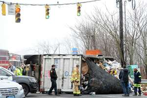 A garbage truck, like this one that rolled over in April 2018, crashed on High Ridge Road Thursday, March 14.