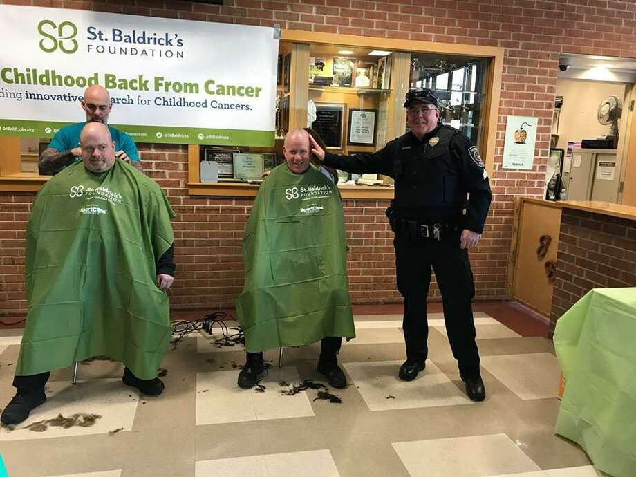 Redding police officers get their heads shaved during Joel Barlow High School's St. Baldrick's event on March 11, 2019. Photo: Redding Police Department / Facebook