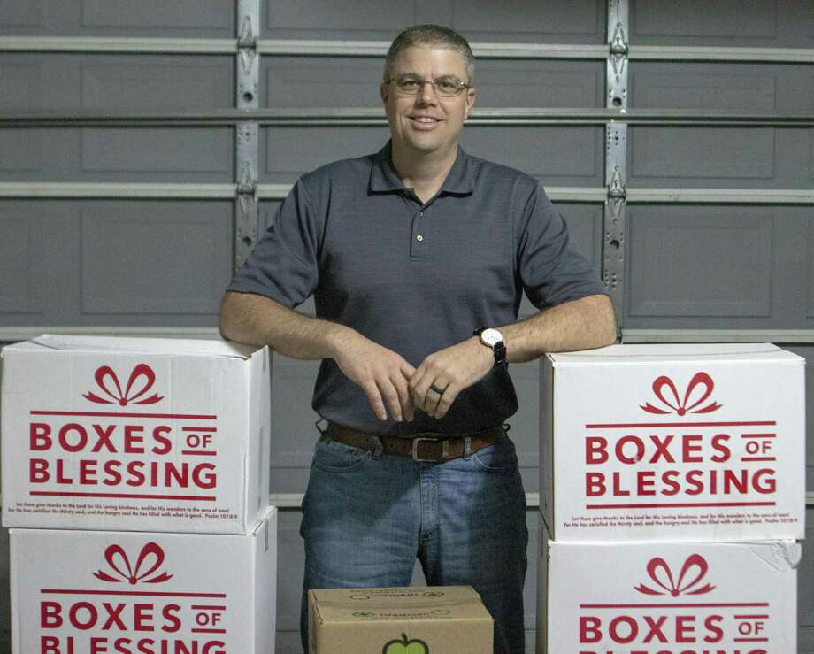 Aaron Clendenen, Elevate 61 operator, poses next to a collection of food he has gathered for donation Wednesday, March 13, 2019 at his home in Magnolia. Elvate 61 is a anti-human traficking program based out of Magnolia. Photo: Cody Bahn, Houston Chronicle / Staff Photographer / © 2018 Houston Chronicle