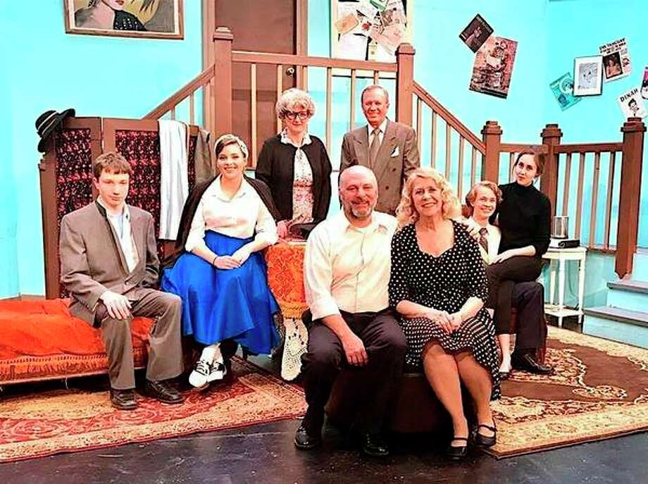 Cass City Teacher Jon Zdrojewski is a consummate community- theater actor. He is pictured front and center, sitting next to Rita Wencel. They acted in Ken Ludwig's 'Moon Over Buffalo,' which previously was performed by the Port Austin Community Players. He has performed in about two dozens plays throughout the Thumb area. (Courtesy Photo)