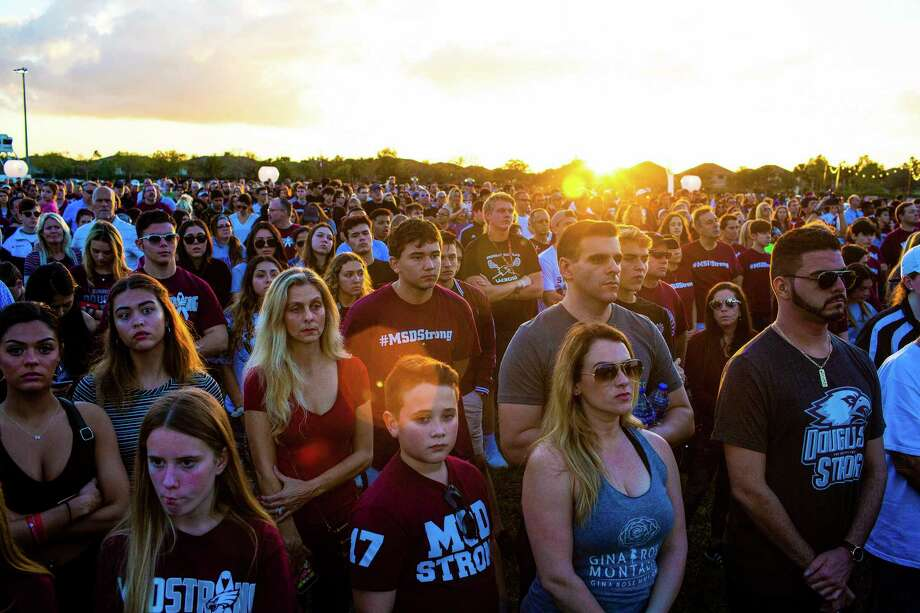 A vigil to honor victims on the one-year anniversary of the shooting at Marjory Stoneman Douglas High School in Parkland, Fla., Feb. 14, 2019. On a day nobody wanted to remember — or forget — Parkland students were observing a day of mourning for the 17 lives lost a year ago. (Saul Martinez/The New York Times) / NYTNS
