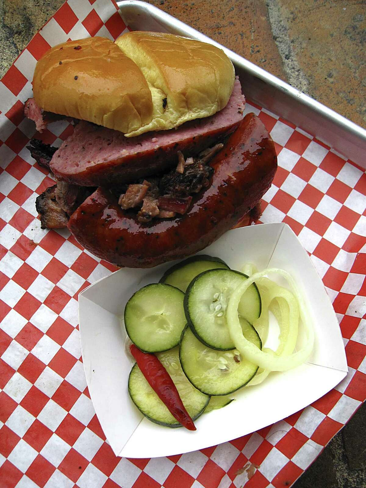 Brisket and sausage sandwich with housemade pickles from Burnwood '68