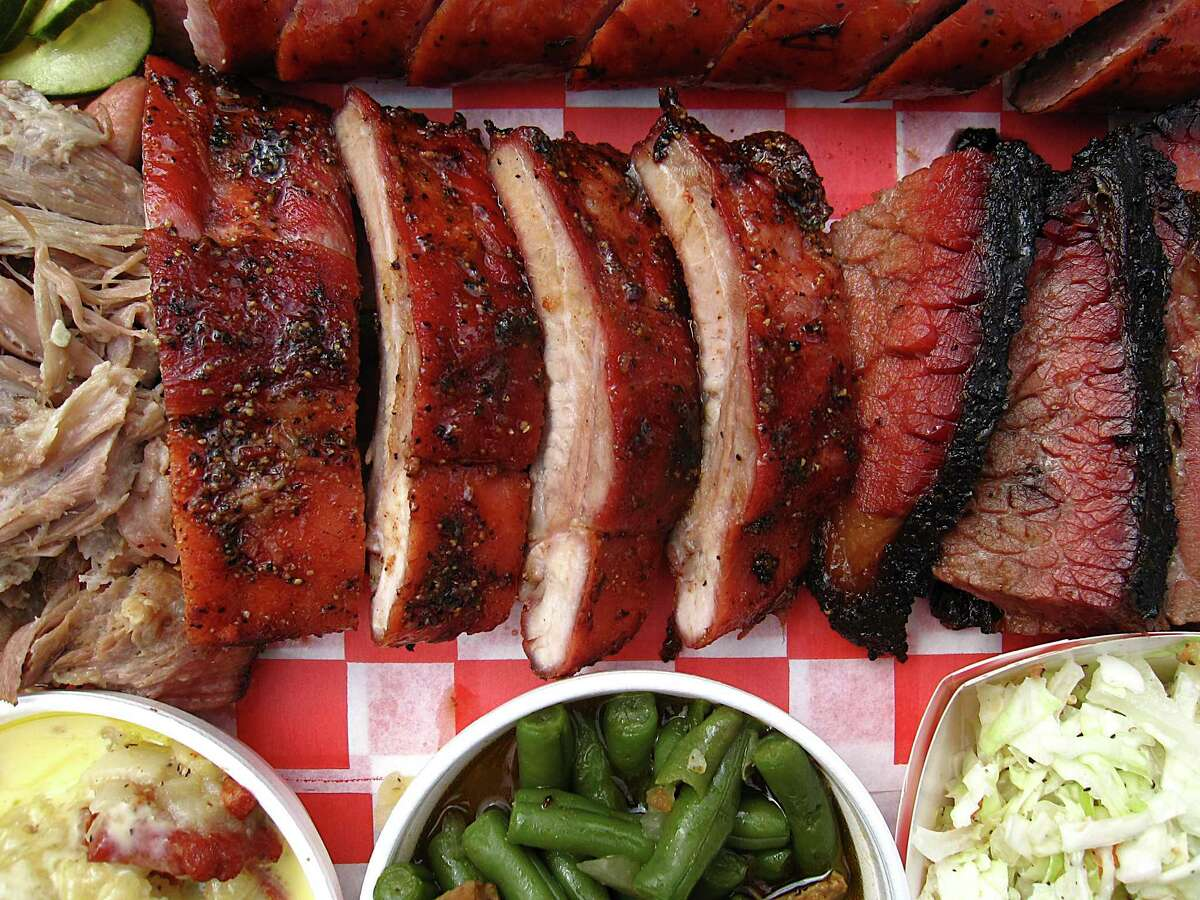 Barbecue and sides from Burnwood '68 include (clockwise from left): pulled pork, sausage, brisket, cole slaw, green beans, cheesy potatoes and pork ribs.