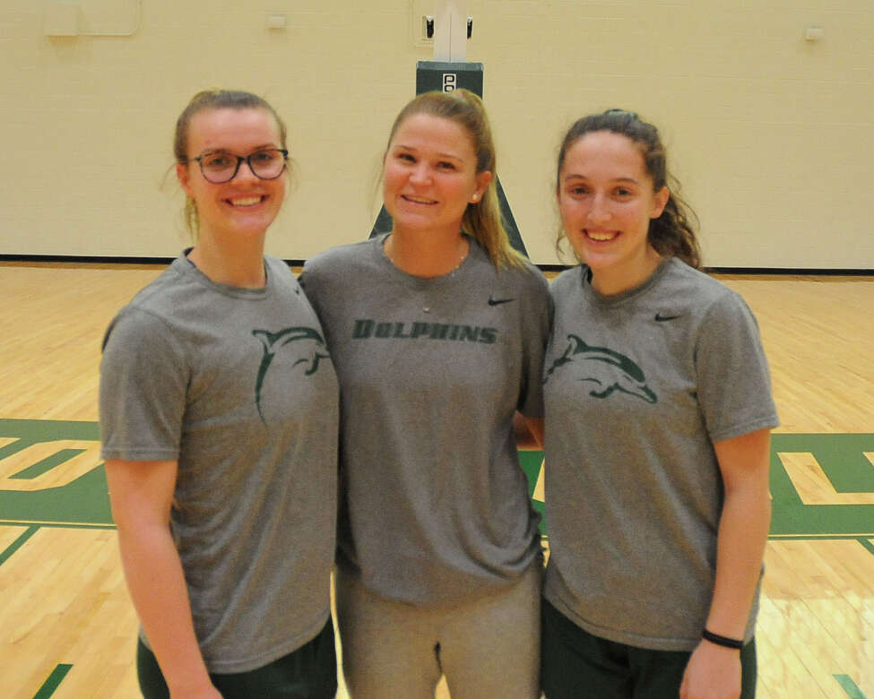 Colonie Central graduate Erin Fouracre, Catholic Central graduate Madison Purcell and Shenendehowa graduate Cameron Tooley after a women's basketball practice on March 12, 2019, at Le Moyne College in Syracuse. Their team won the Northeast-10 Conference Championship Sunday. Now the Dolphins are the fourth seed in the East Regional and will face fifth-seeded Saint Thomas Aquinas College in the regional quarterfinals on Friday at 7:30 p.m. (Le Moyne Athletics / Craig Lane)