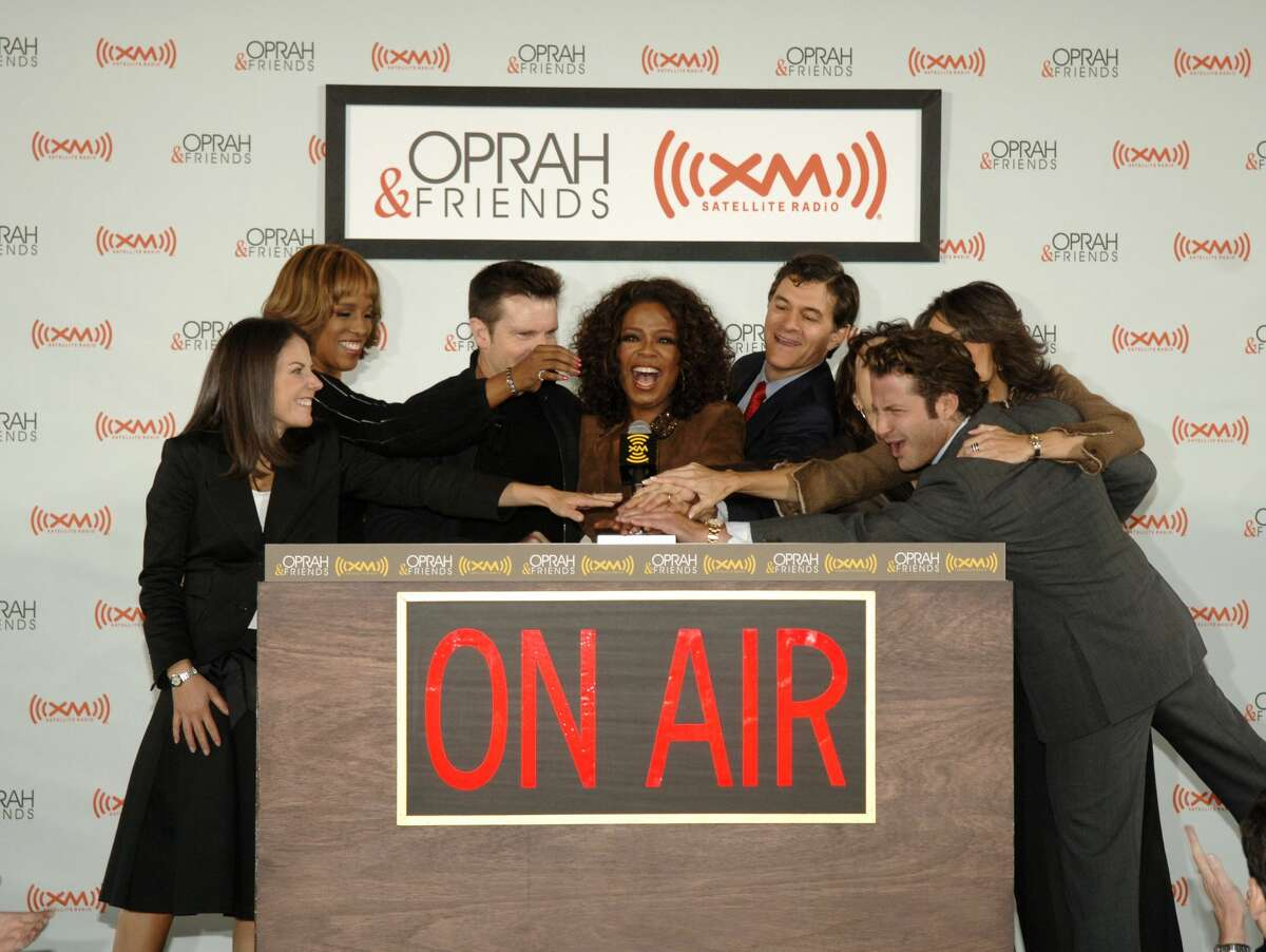 """She's friends with Oprah Winfrey and has been a regular on Winfrey's """"Super Soul Sunday"""" series. Marianne Williamson, far right, is pictured with Jean Chatsky, Gayle King, Bob Greene, Oprah Winfrey, Dr. Mehmet Oz, Dr. Robin Smith and Nate Berkus during Oprah Winfrey and XM Satellite's radio launch of the 'Oprah & Friends' channel on Sept. 25, 2006. (Photo by Larry Busacca/WireImage for XM Satellite Radio)"""