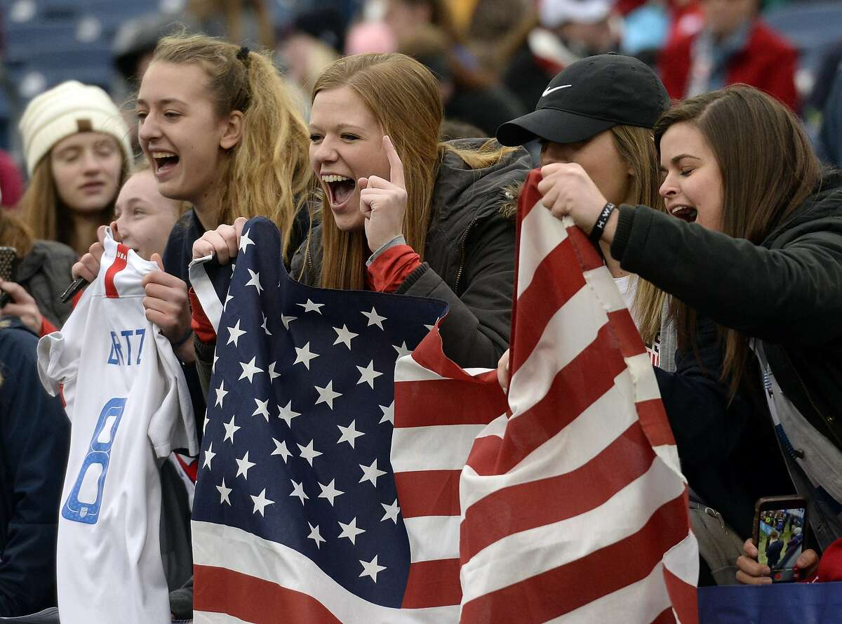 Soccer fans cheer as the the United States women's national team warms up before a SheBelieves Cup women's soccer match against England Saturday, March 2, 2019, in Nashville, Tenn. (AP Photo/Mark Zaleski)