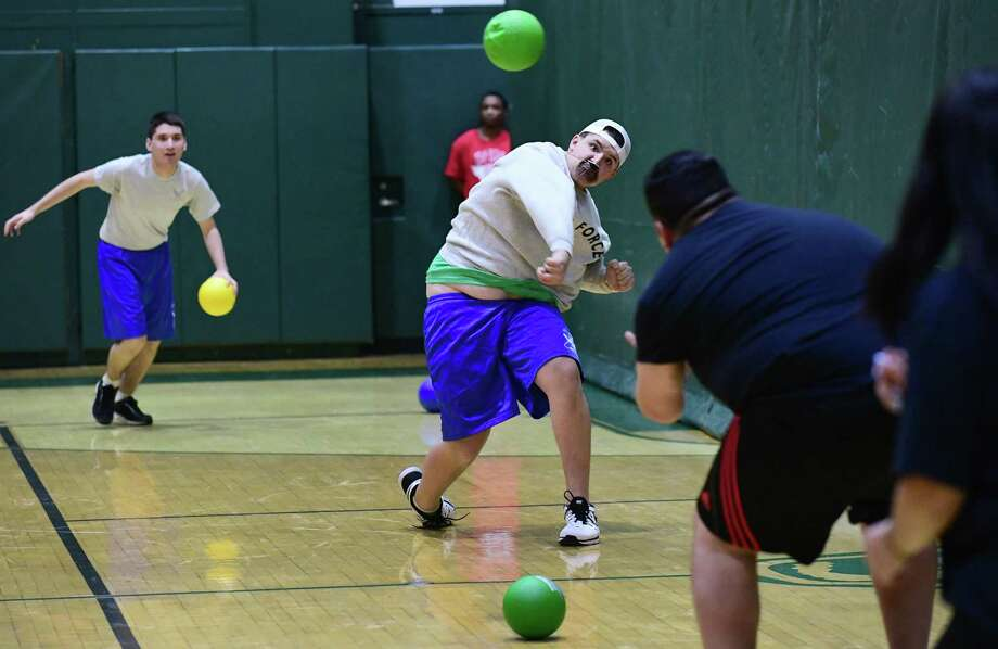 Junior Roman Perez of the ROTC l team throws against the Lights Out team during Norwalk High School's Tenth Annual Charity Dodgeball Tournament Wednesday, March 13, 2019, at the high school in Norwalk, Conn. This year's tournament benefits the Elijah Josiah Gilmore Foundation, a scholarship foundation set up in memory of the son of a Norwalk High School Security Guard and Norwalk High School Helping Hands. Photo: Erik Trautmann / Hearst Connecticut Media / Norwalk Hour