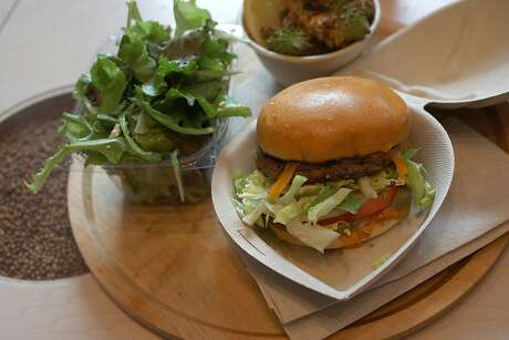 The Recreator burger (made with smoked cheddar, habanero sea salt, alderwood smoked salt, pickles, tomatoes, onion and lettuce), pictured here with salad and fried cauliflower. Photo: Liz Hafalia / The Chronicle