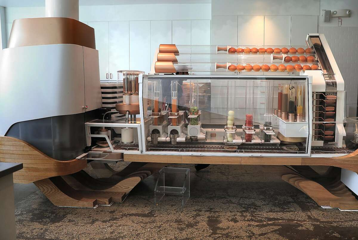 View of Robot A churning burgers at the Creator, the first robot-made burger restaurant seen on Wednesday, March 6, 2019, in San Francisco, Calif.
