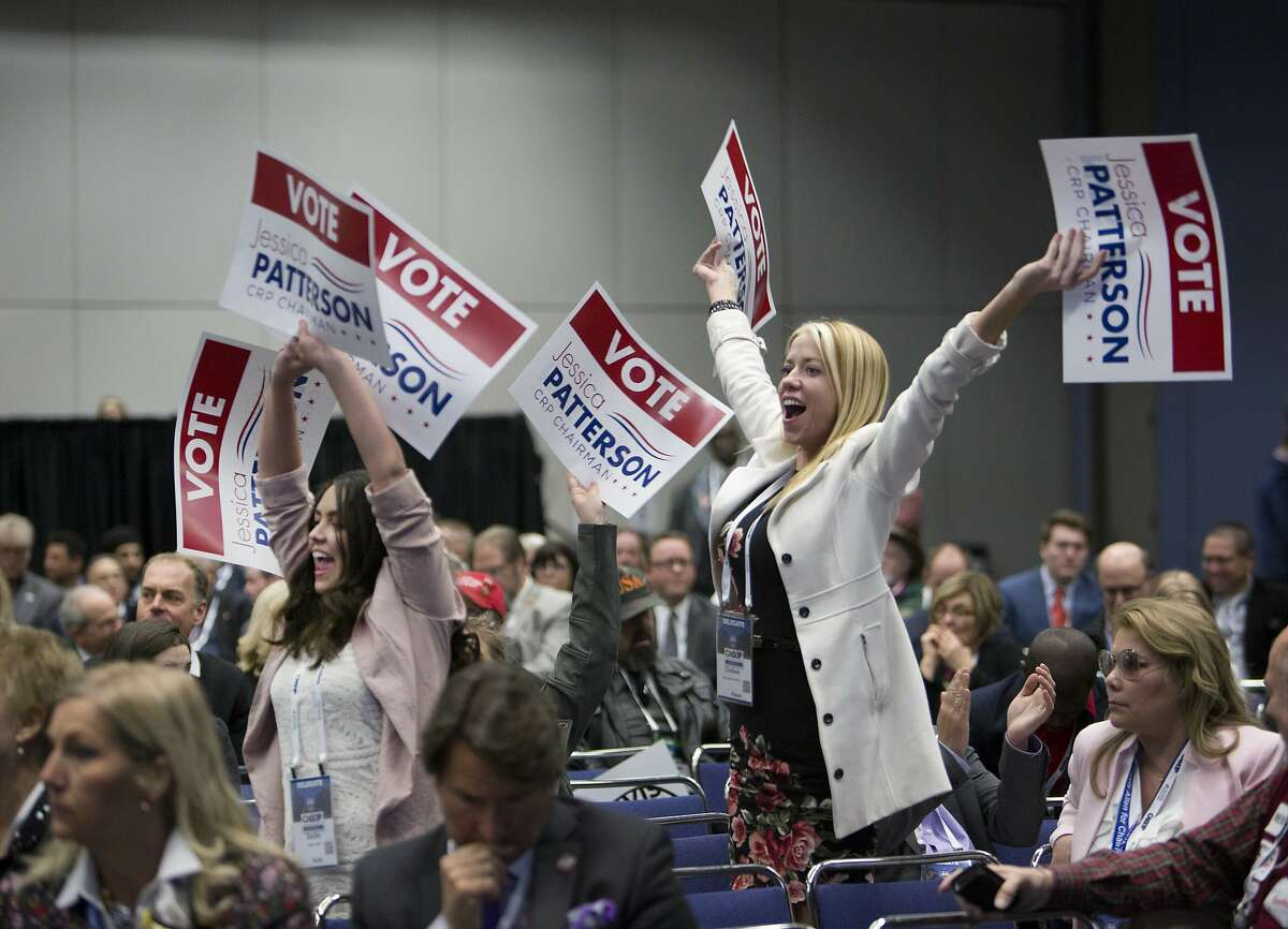 Supporters of candidate for chair of the California Republican Party Jessica Patterson wave their signs during the party convention in Sacramento, Calif., Saturday, Feb. 23, 2019. (AP Photo/Steve Yeater)