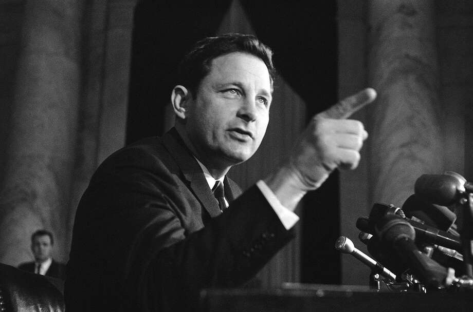 FILE - In this Nov. 8, 1968 file photo, Sen. Birch Bayh, D-Ind., chairman of the Senate constitutional amendments subcommittee, speaks at a news conference in Washington. Bayh, who championed the federal law banning discrimination against women in college admissions and sports, died from pneumonia at his home in Easton, Md., Thursday, March 14, 2019, at age 91, his family said said in a statement. (AP Photo/Henry Griffin, File) Photo: Henry Griffin, Associated Press