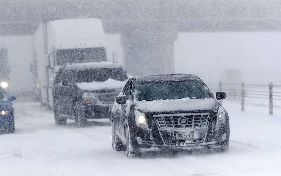 A late-winter snowstorm caused traffic to come to a halt on eastbound Interstate 70 in Aurora, Colo. Photo: David Zalubowski / Associated Press