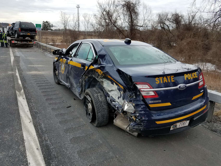 A state trooper parked on the side of the Thruway and a passenger in a disabled car were sent to the hospital after a tractor trailer from Canada hit both vehicles on the shoulder near Kingston. Photo: New York State Police