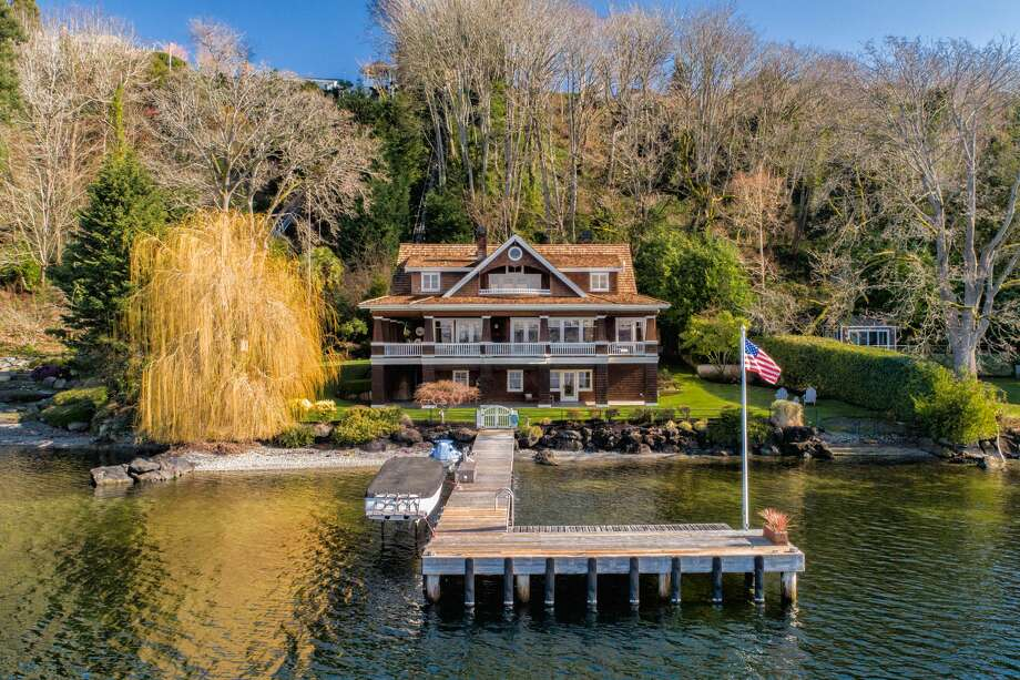 This 5,500-square-foot house for sale in Medina, Washington, not far from Bill Gates' home, includes stunning views west across Lake Washington and a host of amenities. With 125 feet of waterfront, the home includes a private dock and is accessed by taking a tram from the driveway above. Also above is a spacious guest house and three car garage. (Photo by Spencer Redford, Rendering Space for Windermere) Photo: Courtesy Windermere Real Estate