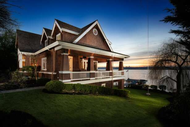 This 4,200-square-foot house for sale in Medina, Washington, not far from Bill Gates' home, includes stunning views west across Lake Washington and a host of amenities. With 125 feet of waterfront, the home includes a private dock and is accessed by taking a tram from the driveway above. Also above is a spacious guest house and three car garage.