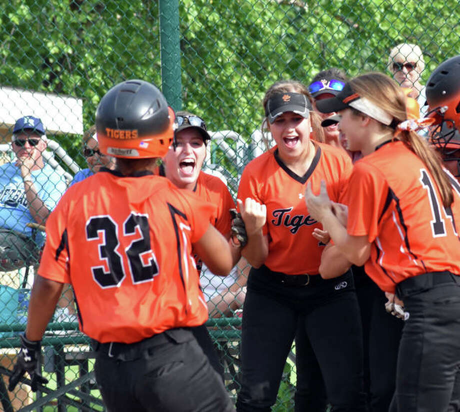 Edwardsville celebrates a home run by Maria Smith during a game last season. Photo: Matt Kamp/Intelligencer