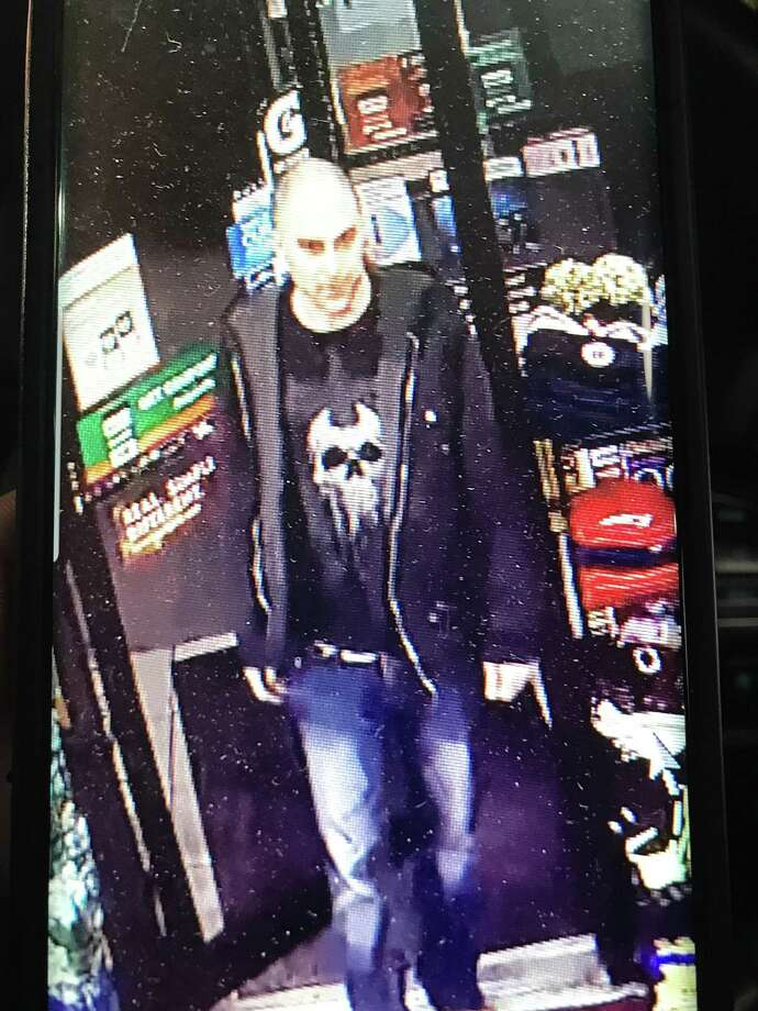 Hamden police are looking for a man accused of stealing a carton of cigarettes fromKrauszer's Food Store. Photo: Hamden Police Department