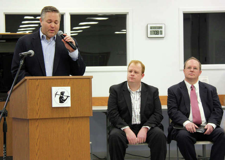 Current Glen Carbon Trustee Bob Marcus begins his remarks Wednesday during a candidate meet and greet at the Glen Carbon Senior Center. At right are write-in candidates Ross Breckenridge, center, and police lieutenant Mark Foley. Photo: Charles Bolinger | The Intelligencer