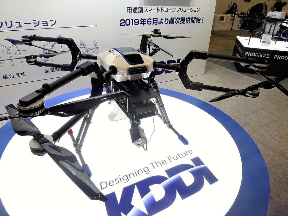 KDDI Corp.'s multipurpose drone is displayed at the Japan Drone fair at Makuhari Messe in Chiba on Wednesday. Photo: Japan News-Yomiuri Photo / Japan News-Yomiuri