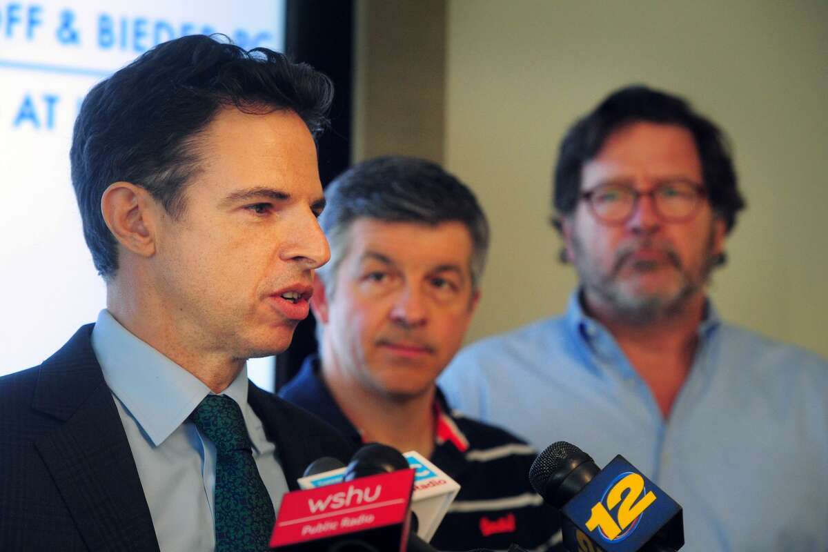 Attorney Josh Koskoff speaks a press conference in Bridgeport, Conn. March 14, 2019. The Connecticut Supreme Court ordered on Thursday that a wrongful death lawsuit, brought by families of victims of the 2012 Sandy Hook Elementary School massacre, against gun manufacturer Remington, can continue to trial. Koskoff is seen here with Ian Hockley, center, father of Sandy Hook Elementary School studen Dylan Hockley, and Bill Sherlach, right, husband of Sandy Hook Elementary School psychologist Mary Sherlach.