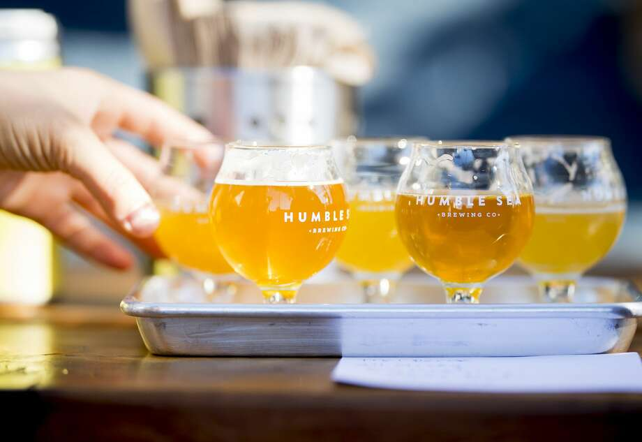 A patron samples beer at Humble Sea Brewing Company in Santa Cruz, Calif., on Saturday, Nov. 18, 2017. Photo: Noah Berger/Special To The Chronicle