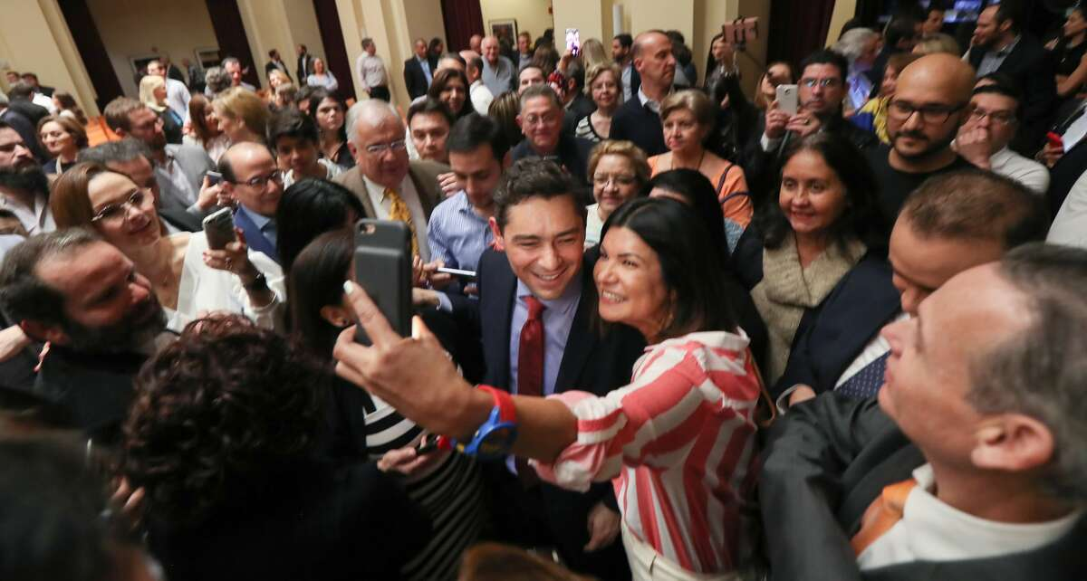 Venezuelan opposition ambassador Carlos Vecchio (center) was surrounded by well-wishers after addressing a large group of people at the James A. Baker III Institute for Public Policy on the campus of Rice University Wednesday, March 13, 2019, in Houston.