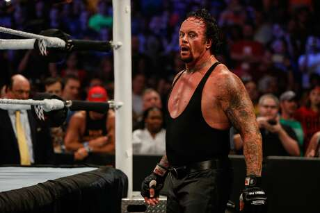 NEW YORK, NY - AUGUST 23: The Undertaker recovers during his fight against Brock Lesner at the WWE SummerSlam 2015 at Barclays Center of Brooklyn on August 23, 2015 in New York City. (Photo by JP Yim/Getty Images)