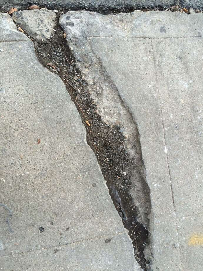 A 2016 image of cracked and damaged sidewalks along Main St. in Bridgeport. Photo: Dan Tepfer / Hearst Connecticut Media / Connecticut Post