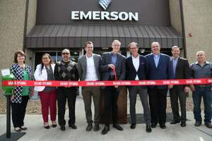 Emerson executives and personal, along with Odessa officials, celebrated the grand opening of Emerson's Permian Basin Service Center.