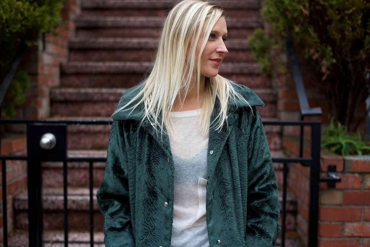 UnionMade employee Kristin McCann wears a Barena coat and top; Levi's jeans and Like Pottery shoes.