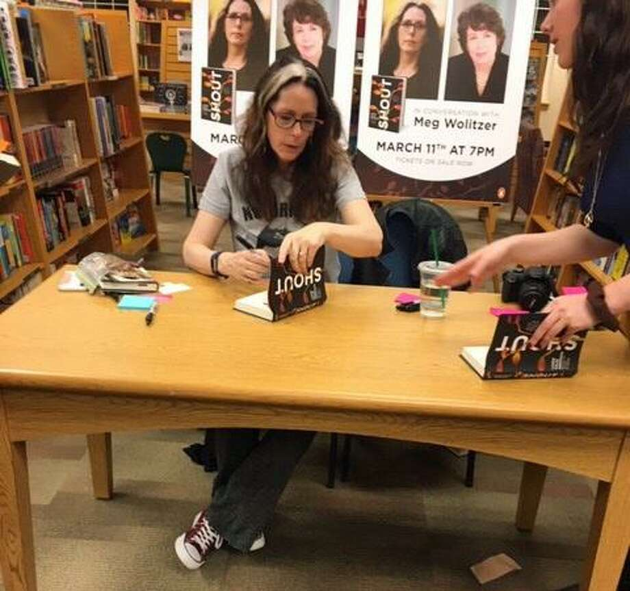 """Laurie Halse Anderson signs copies of her new memoir """"Shout,"""" at the Fairfield University bookstore on March 11. Photo: Contributed"""