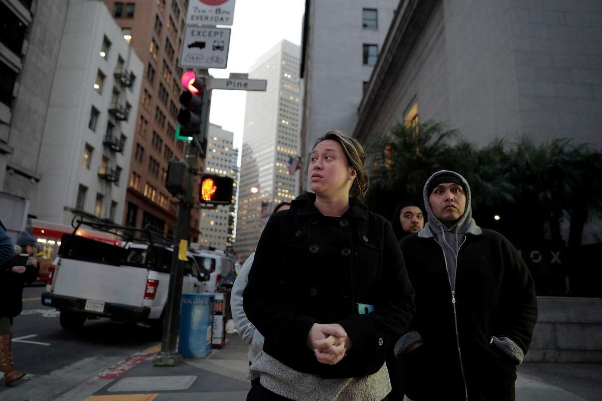 Hay Hov, right, and his wife Catherine Depooter-Hov, left, in San Francisco, Calif., where Hay will to turn himself over to ICE officials on Wednesday, March 13, 2019. Catherine said this is her first time back in the city since the couple's first date seven years ago. Hov was told to turn himself in after being in the U.S. since he was 6 years old, brought by his parents, but he lost his green card at 19 when he was convicted of a crime. The Trump administration is now cracking down on Cambodians and other Southeast Asian undocumented immigrants.