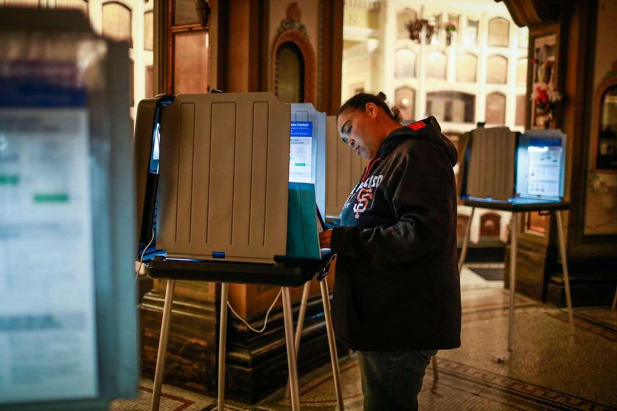 Mikka Kelly votes at the San Francisco Columbarium and Funeral Home in San Francisco, California, on Tuesday, Nov. 6, 2018.