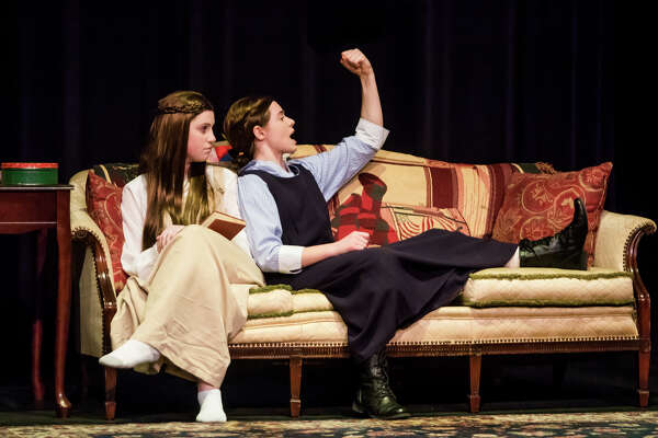"""Adi Hyde in the role of Beth, left, and Sophie Hahn in the role of Jo, right, act out a scene during a dress rehearsal for Bullock Creek High School's production of """"Little Women"""" on Wednesday, March 13, 2019 at Bullock Creek High School. (Katy Kildee/kkildee@mdn.net)"""