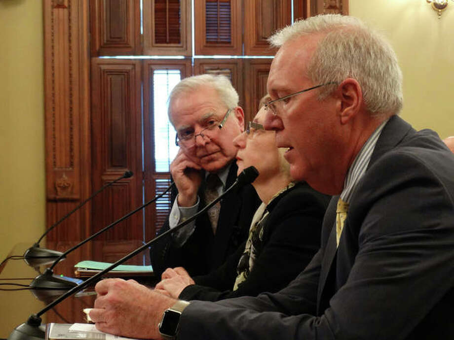 "Dan Reitz (front), a lobbyist for the Illinois Oil and Gas Association, speaks against a bill that would require more public disclosure of hydraulic fracturing, or ""fracking"" operations in the state, while Rep. Robyn Gabel, an Evanston Democrat, and Bill Rau of Illinois People's Action testify in favor of a bill that would impose more disclosure requirements. They all spoke during a House Energy and Environment Committee hearing Tuesday at the Capitol in Springfield. Photo: Peter Hancock/Capitol News Illinois"
