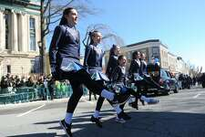 Ryan Benevento, left, and others from the Anam Cara Irish Dance School perform a dance at the Greenwich St. Patrick's Day Parade down Greenwich Avenue in Greenwich, Conn. Sunday, March 18, 2018. Presented by the Greenwich Hibernian Association, the parade featured Irish bagpipe music, Irish dancers, floats from many local organizations, as well as Greenwich police, fire and EMS.