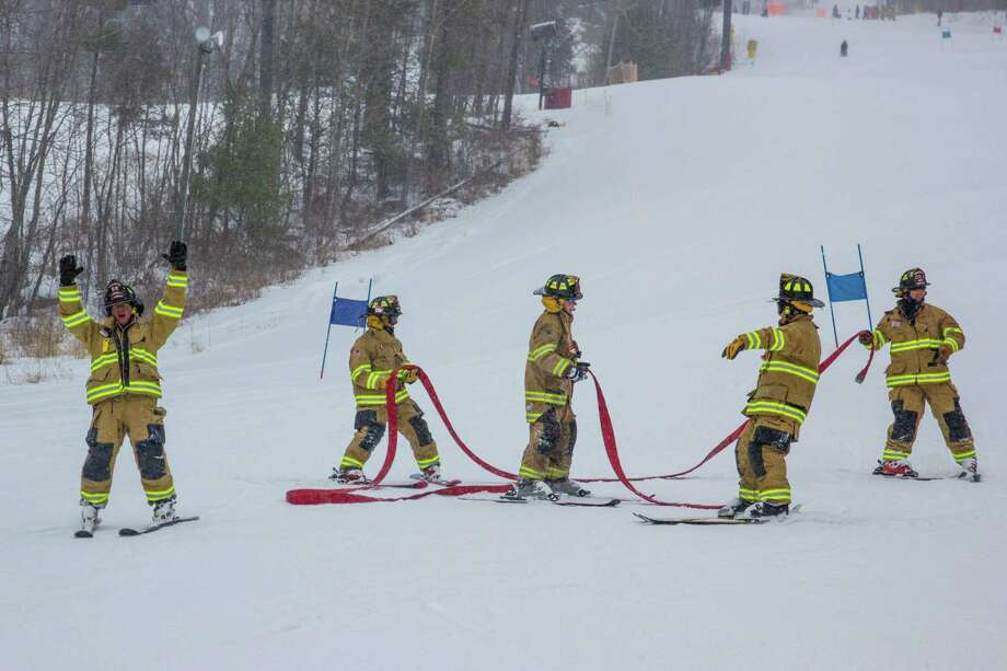 Firefighters from around the state competed in the annual firefighters ski race at Mohawk Mountain Sunday, March 10. The event, a fundraiser for the burn unit at Bridgeport Hospital, resulted in $1,200 raised by the 8 participating teams. Above, a team celebrates completing the run down the mountain. Photo: Tom Mitchell, Mohawk Mountain / Contributed Photo /