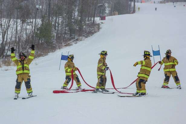 Firefighters from around the state competed in the annual firefighters ski race at Mohawk Mountain Sunday, March 10. The event, a fundraiser for the burn unit at Bridgeport Hospital, resulted in $1,200 raised by the 8 participating teams. Above, a team celebrates completing the run down the mountain.