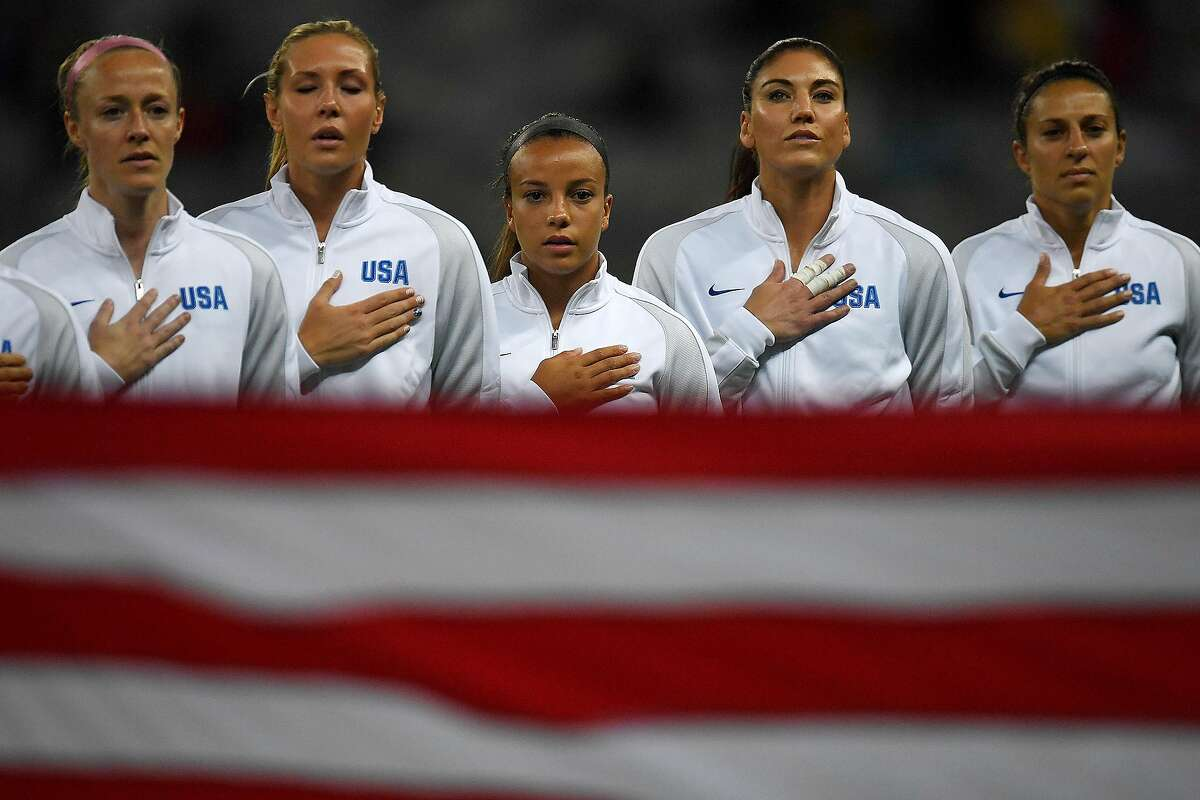 BELO HORIZONTE, BRAZIL - AUGUST 03: Becky Sauerbrunn (4) of the United States, Allie Long (3), Mallory Pugh (2), Hope Solo (1) and Carlie Lloyd (10) stand for their country's national anthem before the first half of their first round Rio 2016 group G match against New Zealand. (Photo by AAron Ontiveroz/The Denver Post via Getty Images)