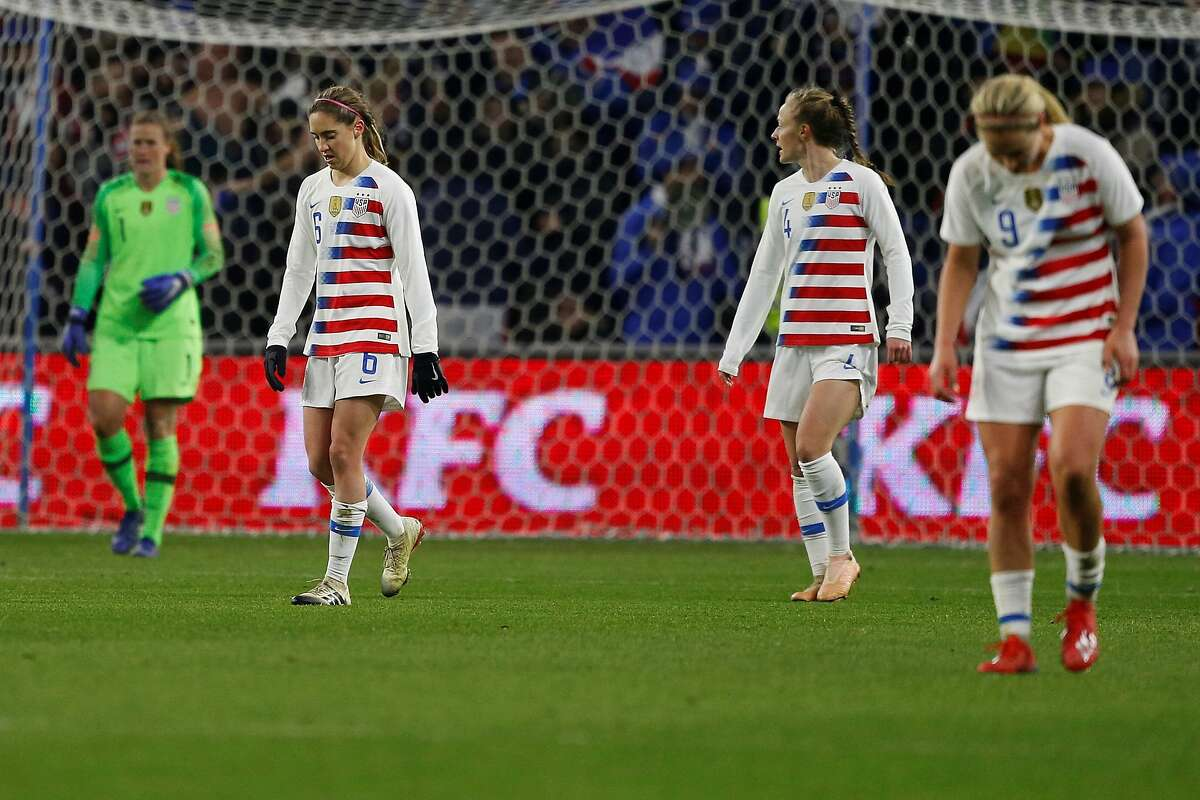 USA's Morgan Brian (L) reacts after conceding a goal during the women's friendly football match between France and USA at Oceane stadium in Le Havre, on January 19, 2019. (Photo by CHARLY TRIBALLEAU / AFP) (Photo credit should read CHARLY TRIBALLEAU/AFP/Getty Images)