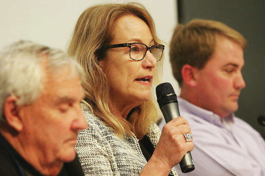 Godfrey trustee candidate Virginia Wolfe-Beille makes an opening statement while incumbent Ben Allen, left, and challenger Jerome Jacobs listen during the Godfrey trustee candidates forum held March 13 at Lewis and Clark Community College. About 110 people came out to hear from five of six candidates running for three Village Board seats. The forum was sponsored by the East End Improvement Association and the North Alton-Godfrey Business Council.
