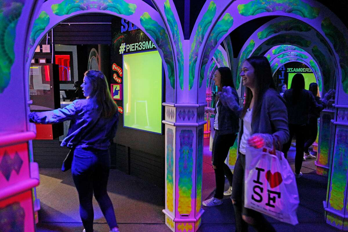 From left: Audrey Price and Katie Schuller complete the Magowan's Infinite Mirror Maze at Pier 39 on Thursday, March 14, 2019, in San Francisco, Calif.