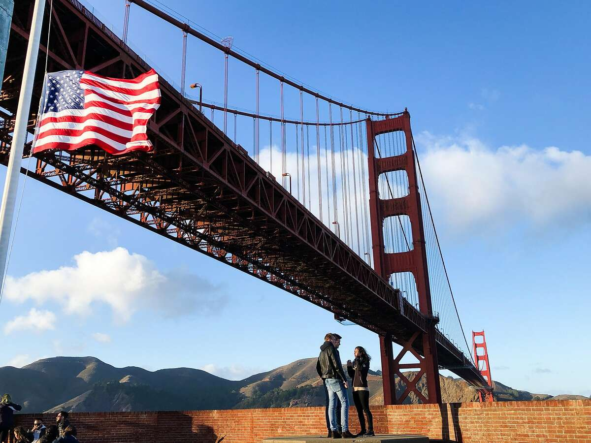 Visitors walk on the roof of Fort Point on Saturday, Dec. 1, 2018, in San Francisco, CA. The Golden Gate Bridge towers above Fort Point.