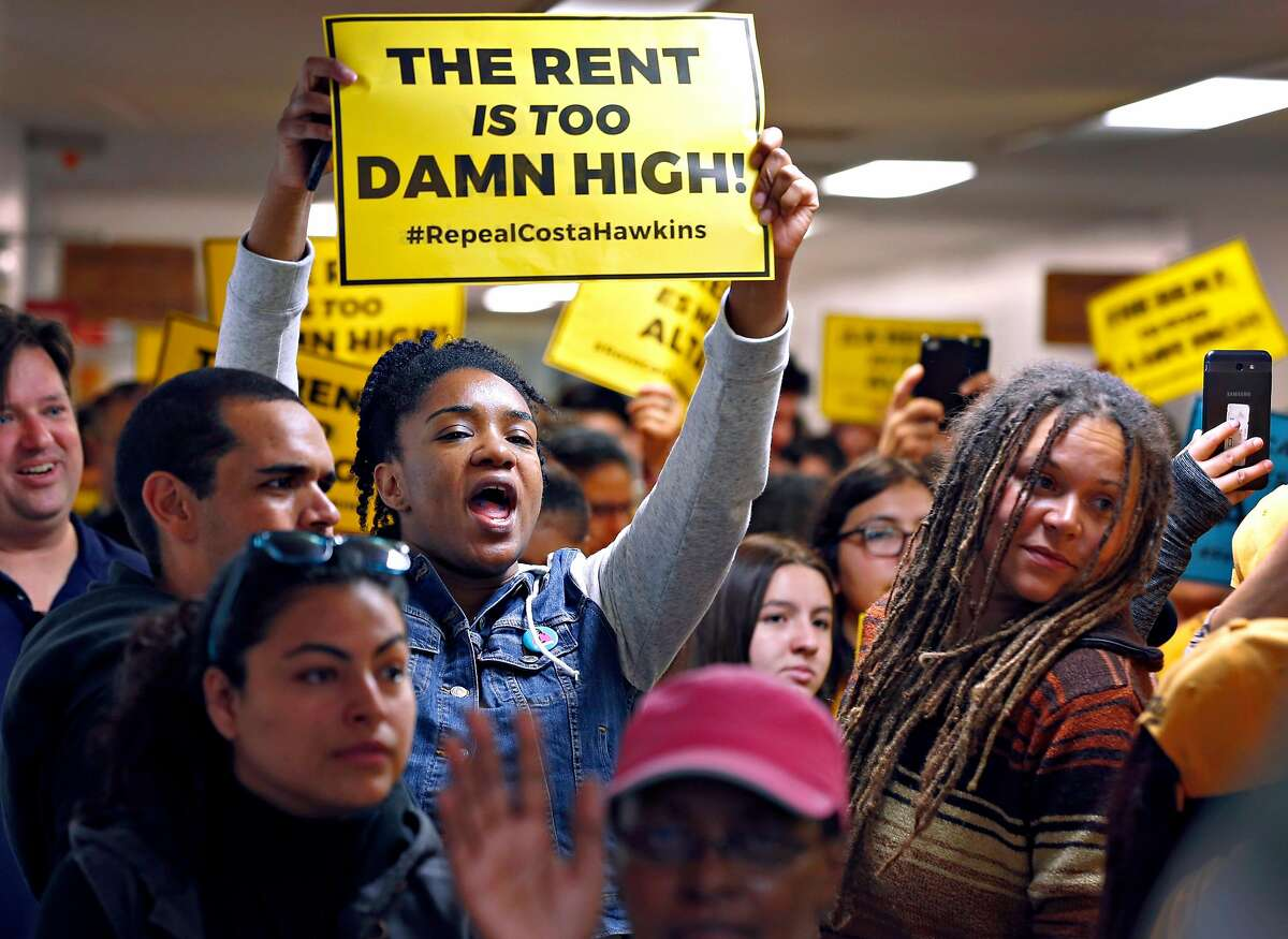 Sasha Graham (left) of Richmond joins other tenants rights supporters in a crowded hallway before the doors open for a joint hearing on the statewide ballot measure to repeal the Costa-Hawkins rental housing act at the State Capitol in Sacramento, Calif. on Thursday, June 21, 2018.a joint hearing on the statewide ballot measure to repeal the Costa-Hawkins rental housing act at the State Capitol in Sacramento, Calif. on Thursday, June 21, 2018.