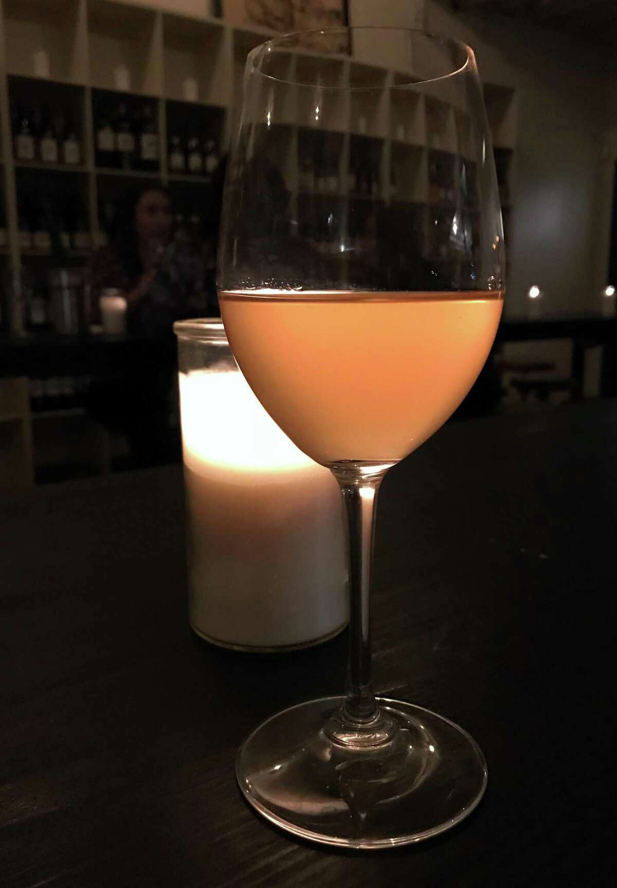 A glass of orange wine made by the German producer Enderle & Moll served at the new St. Mary's Strip wine bar Little Death