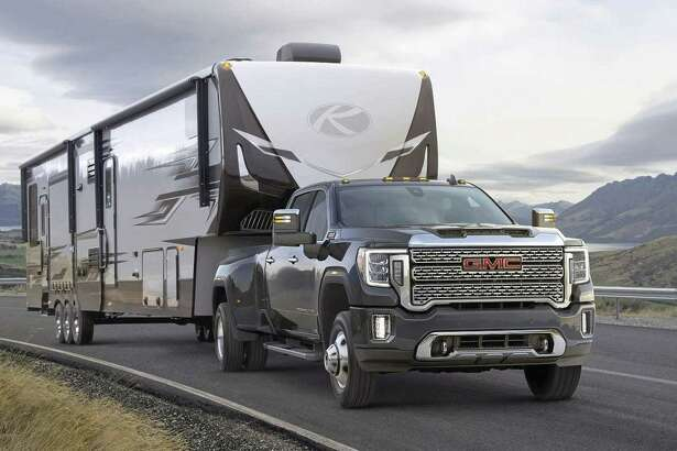 Those planning on doing some gooseneck towing should note that the 2020 GMC Sierra 3500 HD, equipped with Duramax turbo-diesel engine and dual rear wheels like this Denali, is rated to tow up to 35,500 pounds when properly equipped. The truck will reach dealerships later this year. (GMC photo)